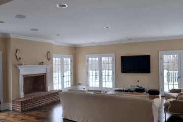 Family Room with Brick Fireplace, Marvin Patio Doors, & Wide Plank Pine Flooring.