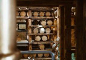 wooden-wine-barrels-on-shelf_925x